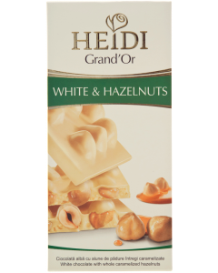 Ciocolata alba cu alune padure si fulgi porumb Heidi Grand'or 100g